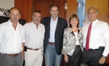 Líderes del Unión PRO, con Cassani