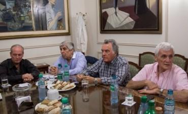 Moyano y Caló anunciaron que la CGT se unirá en agosto